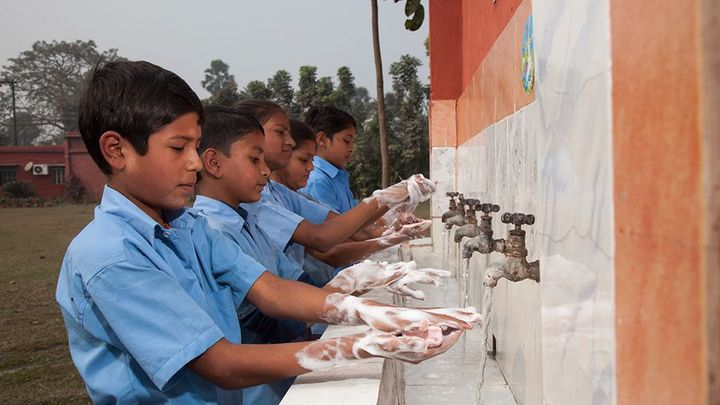 Children washing hands with Lifebuoy soap