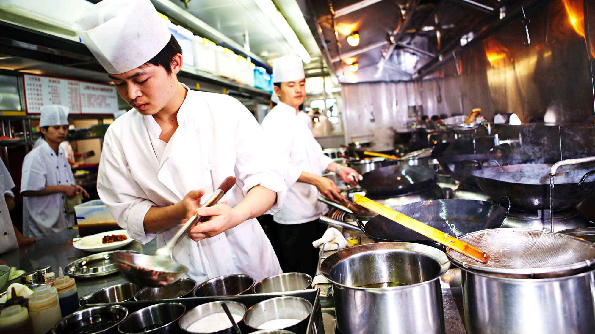 Chefs prepare meals using Unilever products