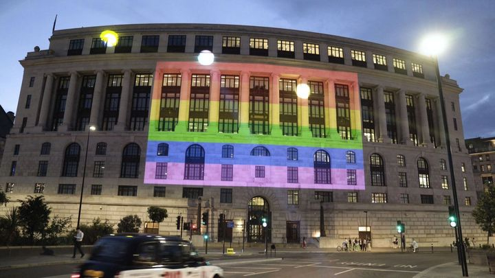 A Pride flag on the side of a building in London