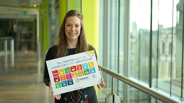 Woman holding a Global Goals sign
