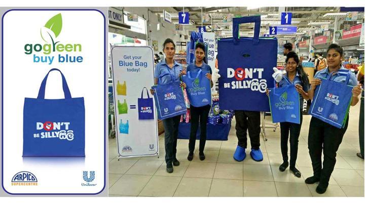 Girls holding buy blue bags