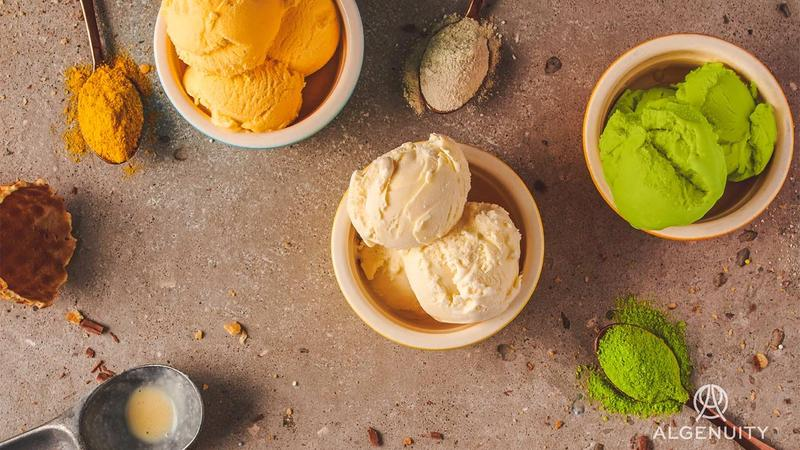 Three small bowls of ice cream on a table.