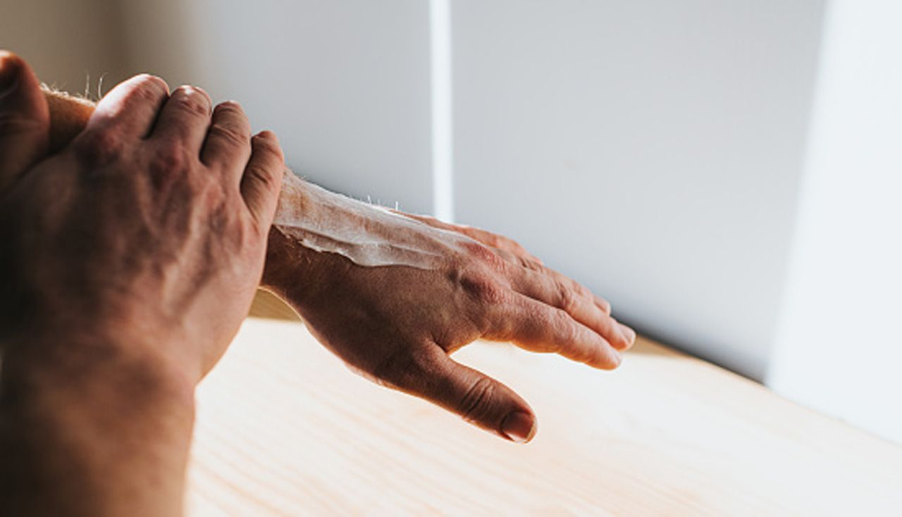 Wiping cream into hand