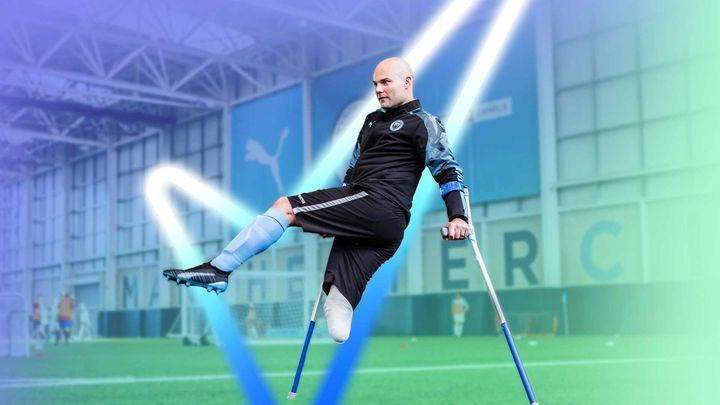 Disabled footballer taking part in an indoor training session