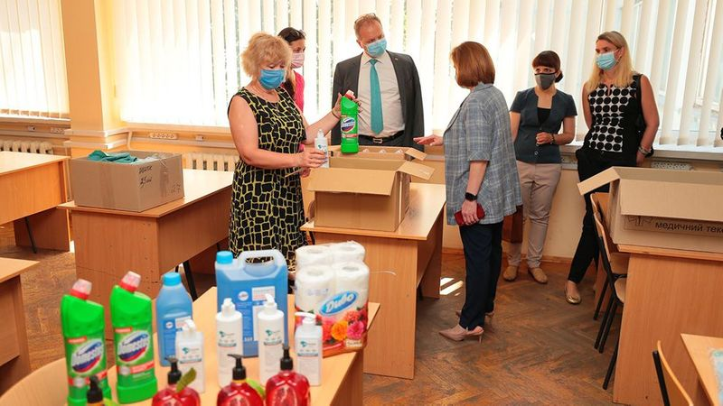 Unilever products, including Domestos, being unpacked in a school classroom