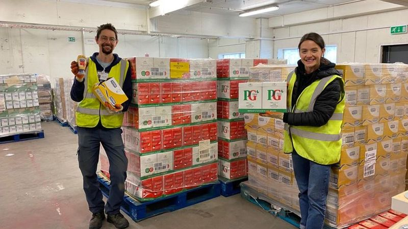 Volunteers for Unilevers charity partner Fare Share smiling with a large donation