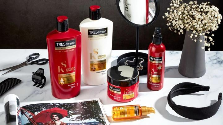 A photo of TRESemmé haircare products on a dressing table. TRESemme is now PETA-Approved