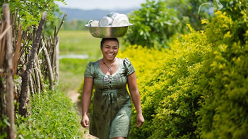 Woman carrying dishes