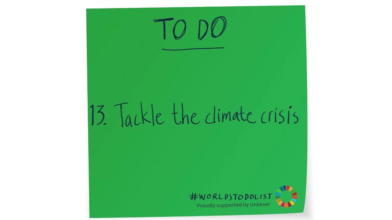 Green sticky note with Tackle the climate crisis written on it