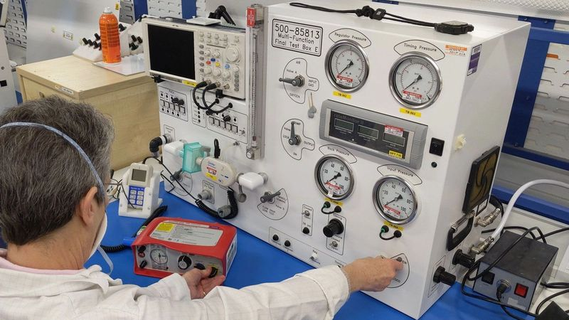 A scientist testing a ventilator at one of the companies producing equipment for the UK Ventilator Challenge consortium.