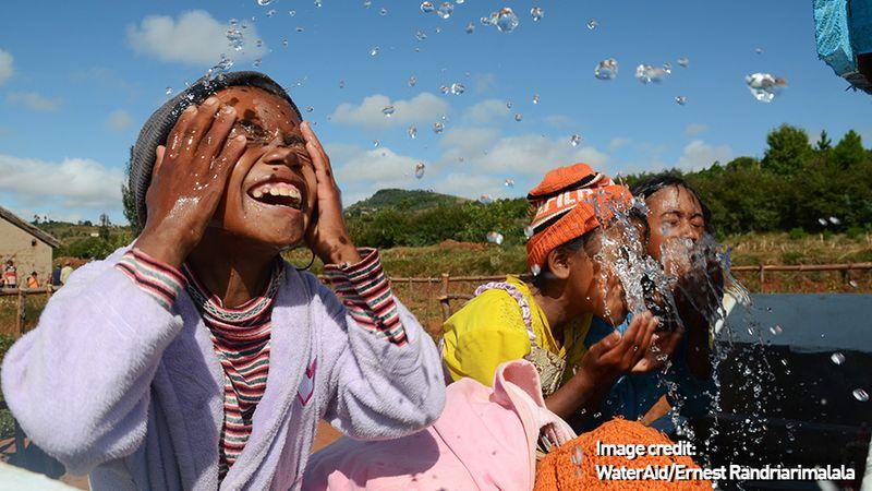 Children splashing water on their faces