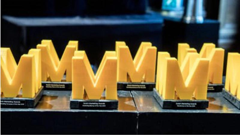 """Rows of yellow, M-shaped awards. Photo by Bart van der Putten"""""""