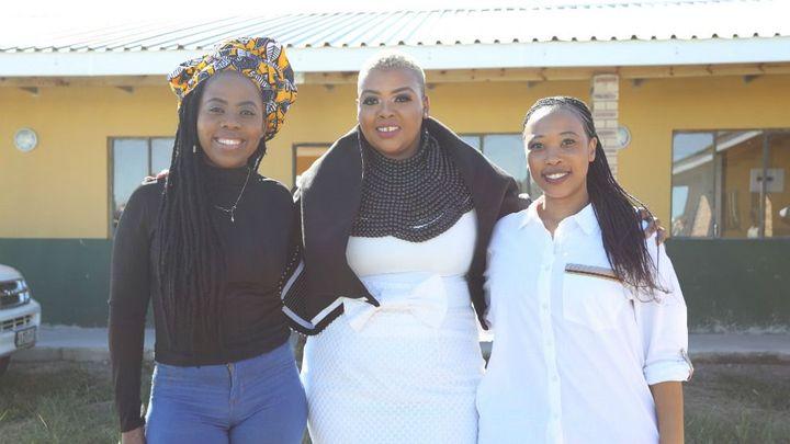 Three African women smiling