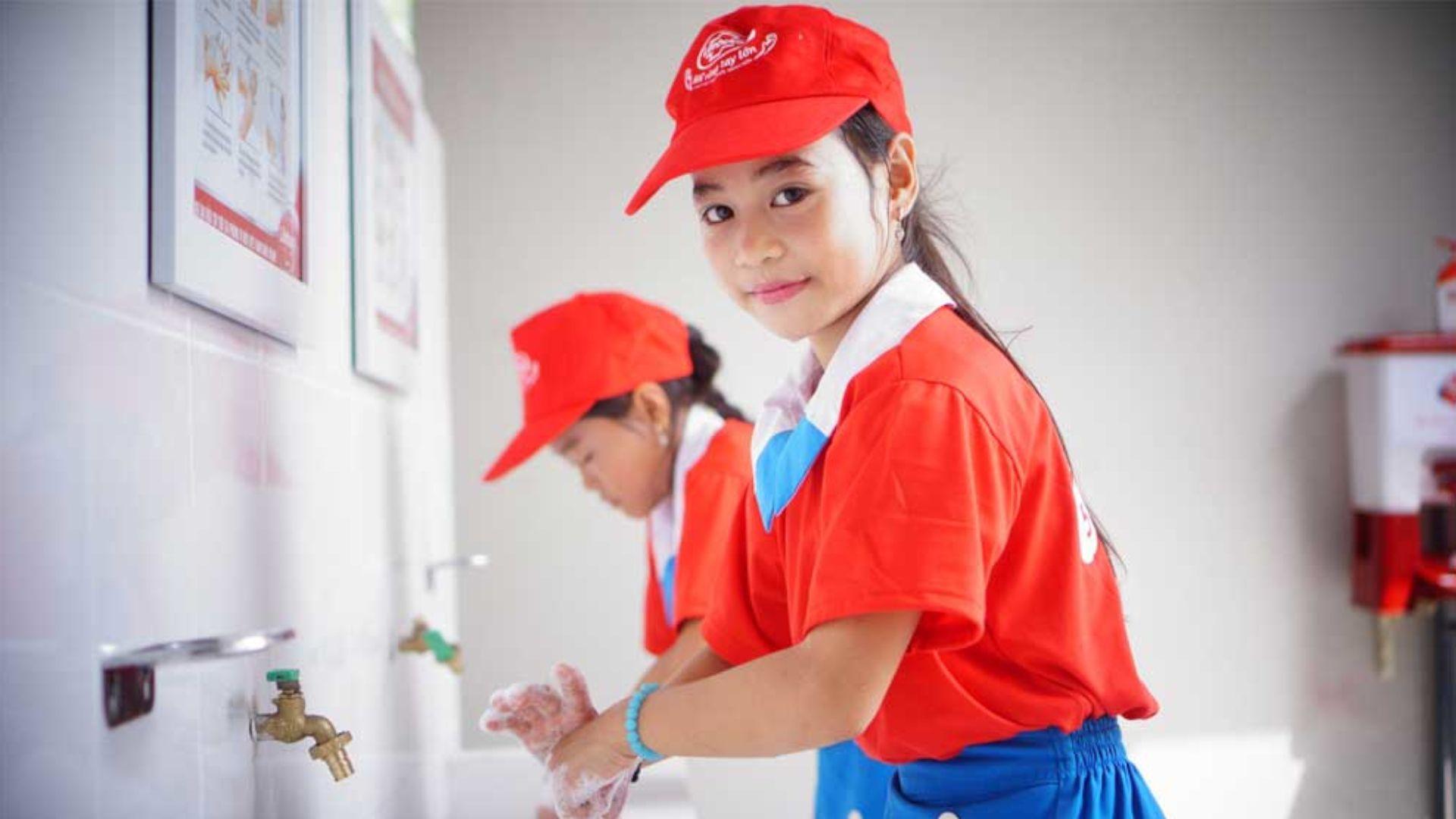 Girls washing their hands