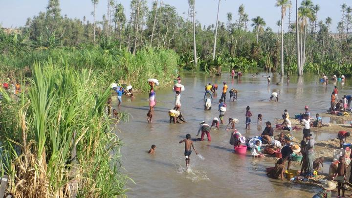 Villagers in Magadgascar using river for drinking water and domestic use
