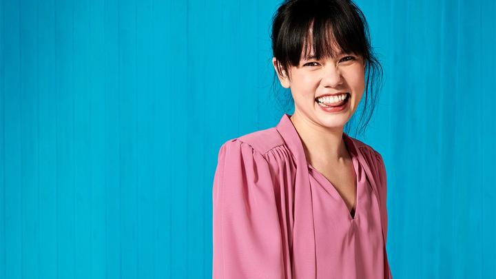 Woman in pink blouse, laughing