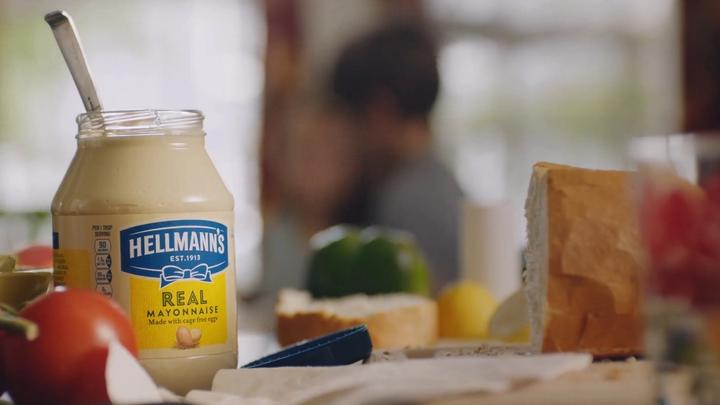 A jar of Hellmans mayonase with bread and tomatos