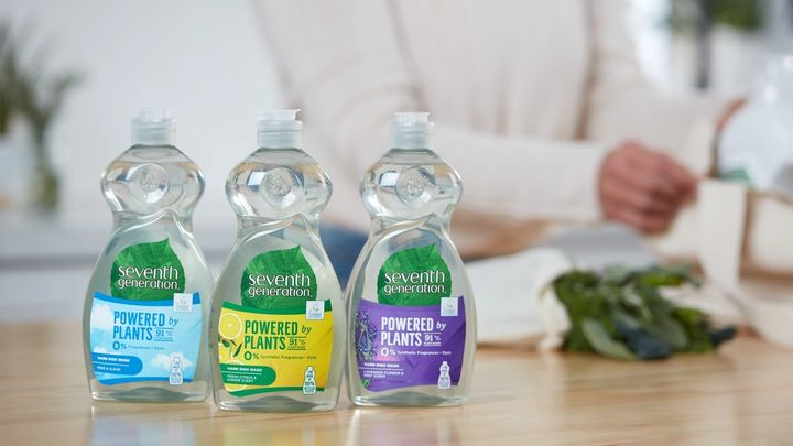 Bottles of Seventh Generation washing-up liquid lined up on a table