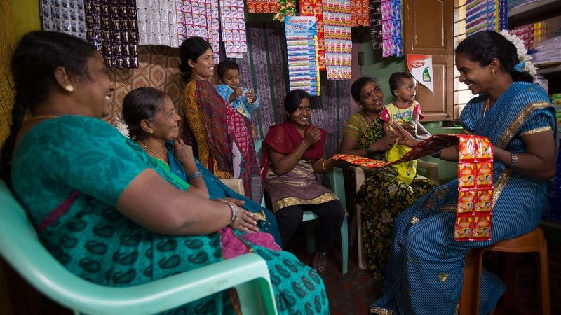A group of women buying from a Shakti micro-entrepreneur in India