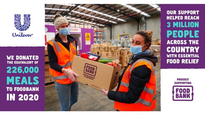 Foodbank volunteers receiving Unilever donation in the factory