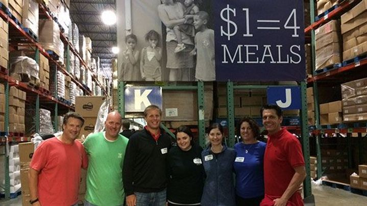 A group of people, volunteering for a hunger relief programme