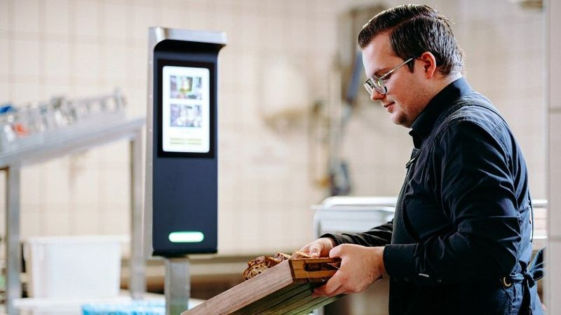 Man controlling food waste with technology