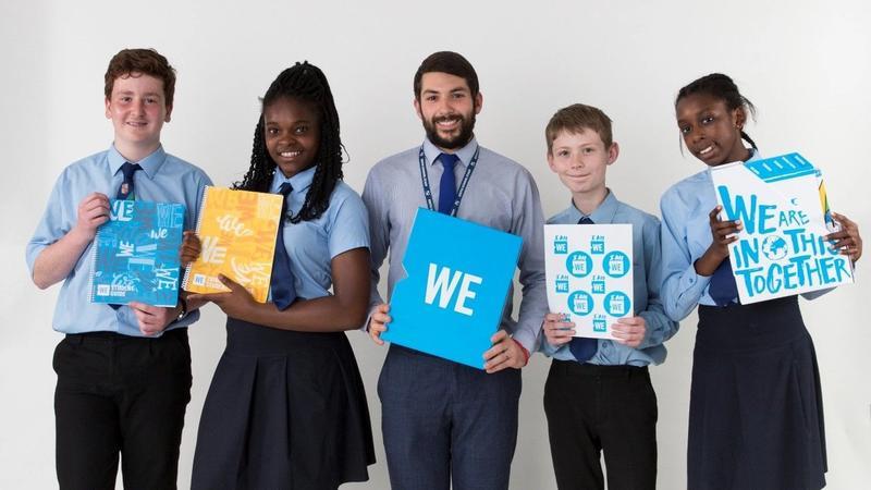 UK Children carrying WE schools amblems