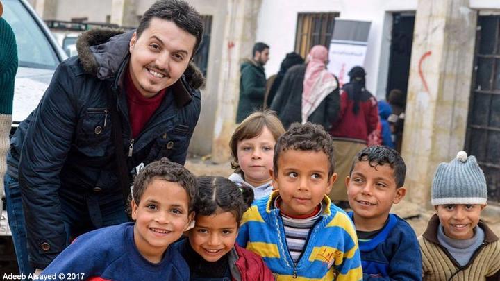 Anas Anjrini with children in Aleppo