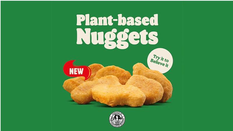 """Plant-based chicken nuggets against a green background"""""""