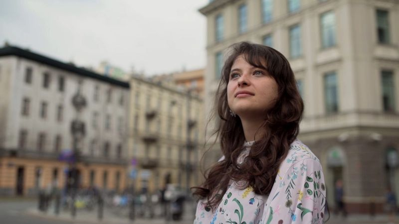 Martyna Kaczmarek looking thoughtful on St Saviour's Square, Poland