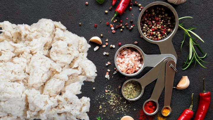 Fungi-based plant protein ABUNDA, developed by food tech firm ENOUGH, sitting on working surface with spices
