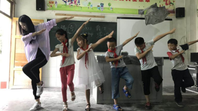 teacher dancing with students