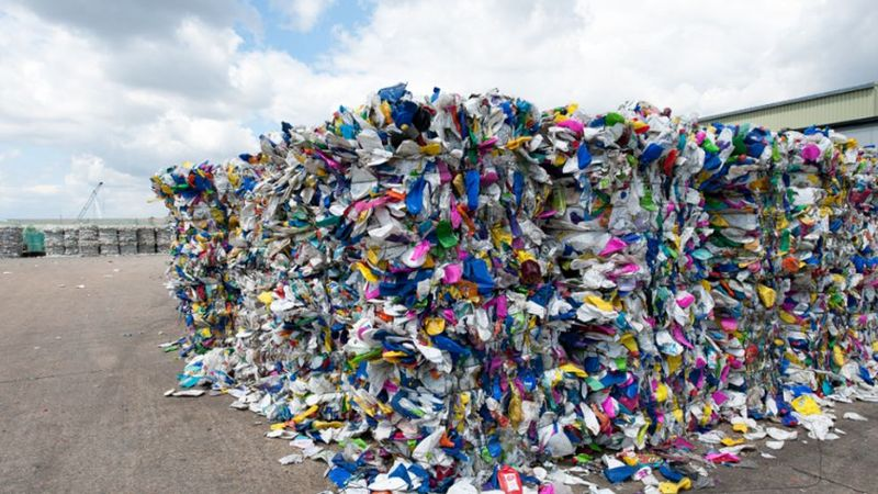 Veolia recycling facility showing a pile of mixed PET plastic ready to be recycled