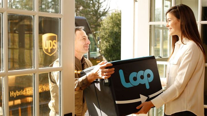 Ups driver delivering a package