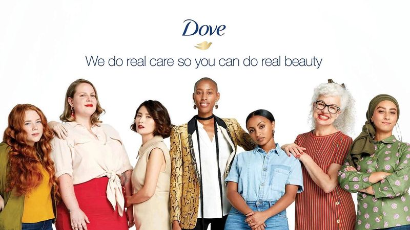 Dove Real Beauty campaign poster with a diverse group of women standing in a line