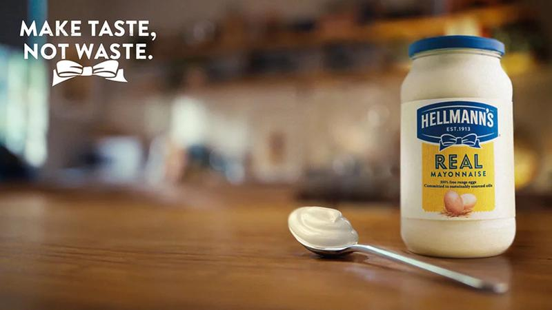 A jar and spoon of Hellmann's mayonnaise showcasing the brand's Make Taste, Not Waste campaign