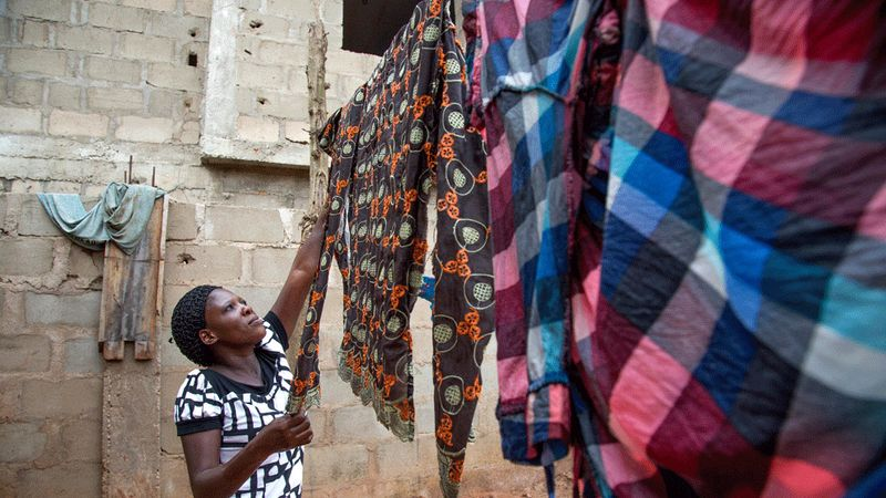 Woman hanging clothes