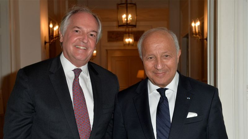 Businessmen smiling