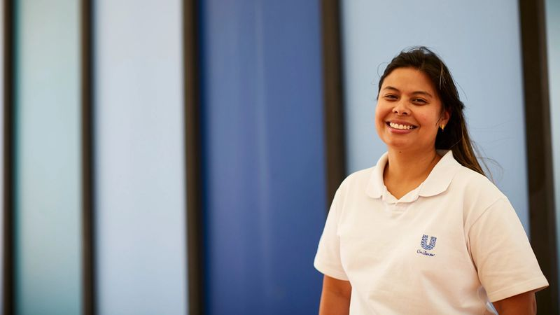 Woman wearing a Unilever t-shirt at our factory in Brazil