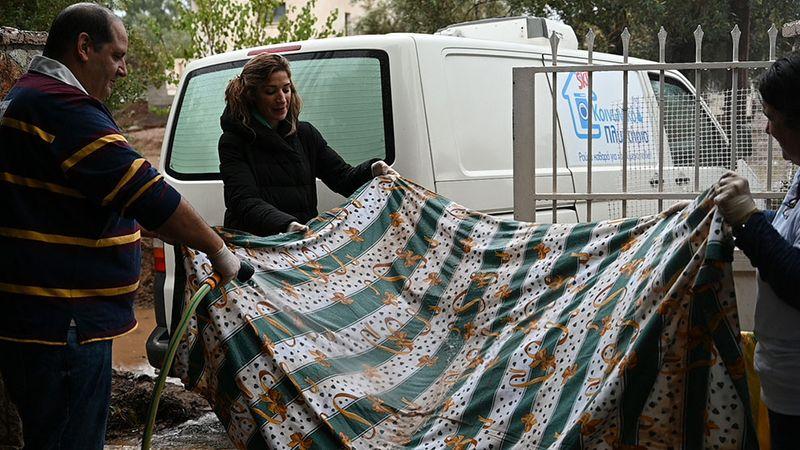 SKIP- People washing a blanket