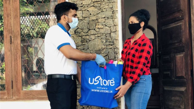 A consumer receiving a delivery of Unilever Sri Lanka products ordered via the www.ustore.lk website