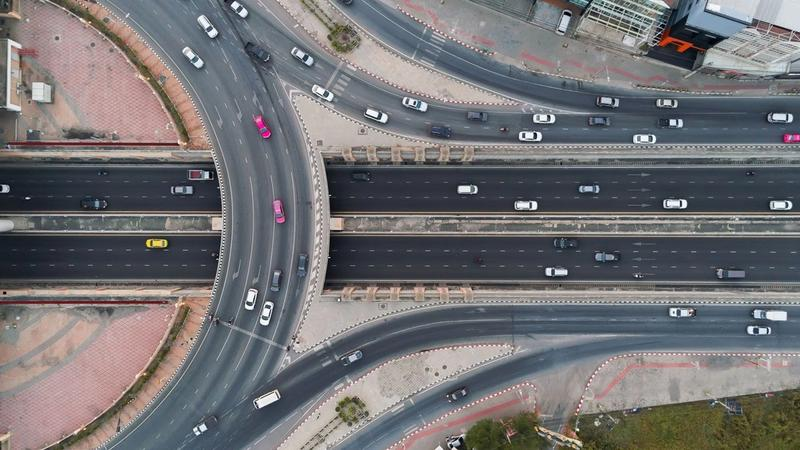 An aerial view of cars driving around a motorway junction