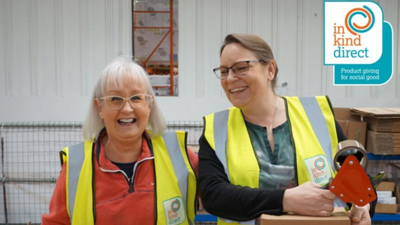 Volunteers smiling in the warehouse of Unilever's charity partner, In Kind Direct