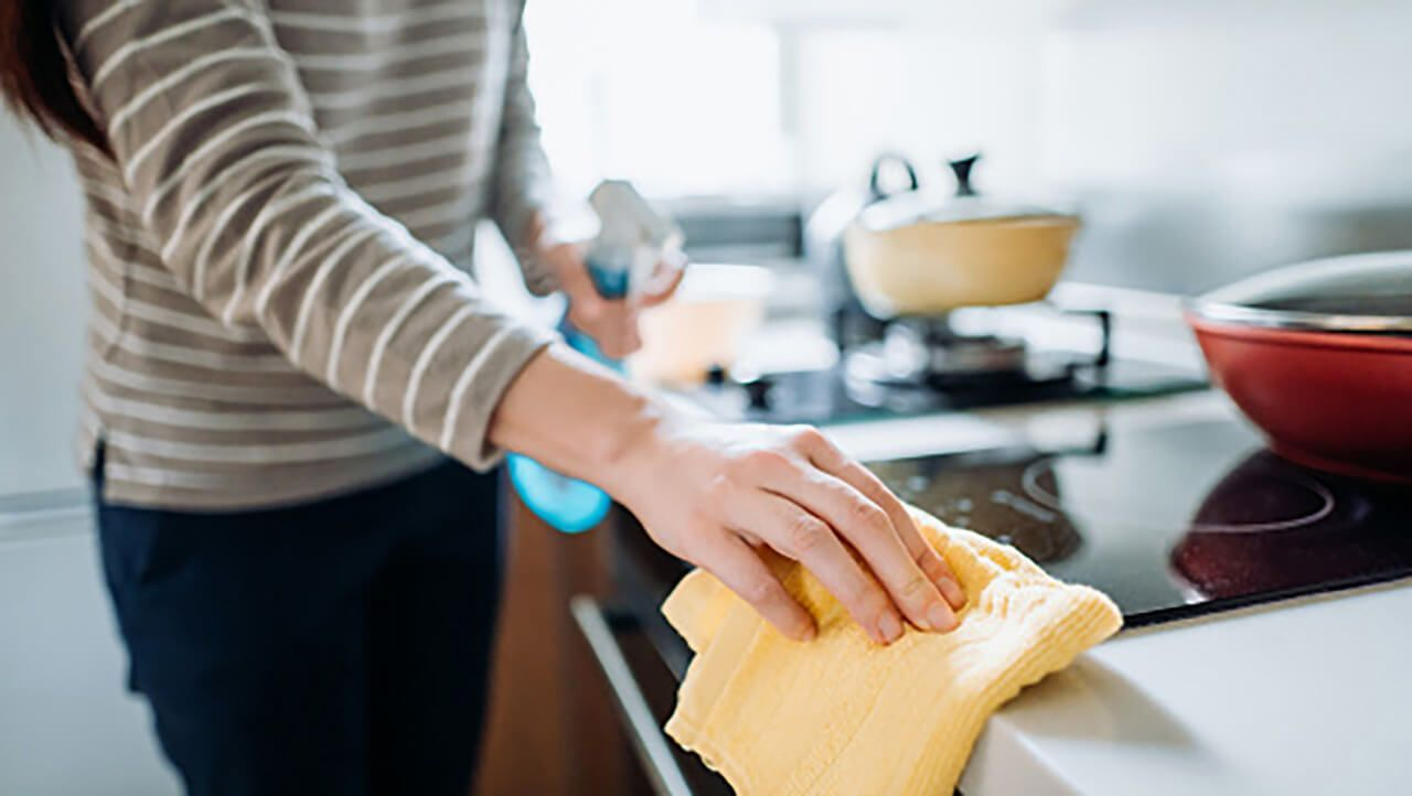 A person cleaning their kitchen