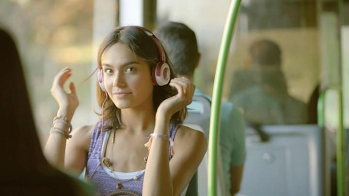 Girl with headphones on public transport