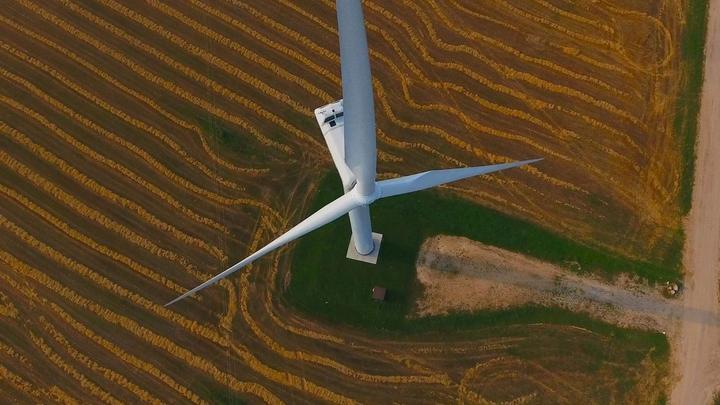 An aerial photograph of a wind turbine.