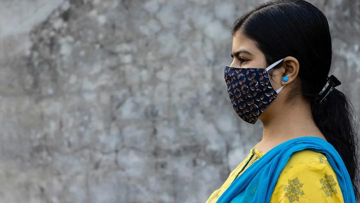 Side Face of an Indian woman wearing homemade cotton mask