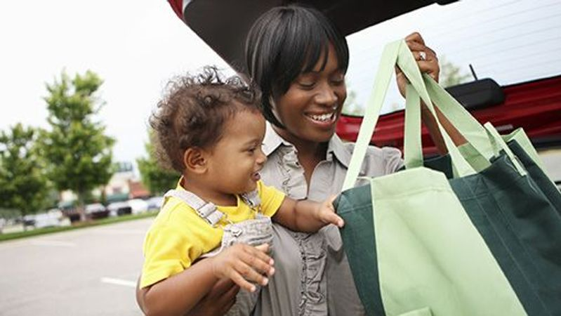 Woman and child with tote bag