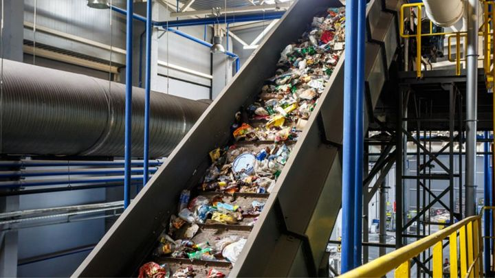 Machinery moving plastics that will be recycled.