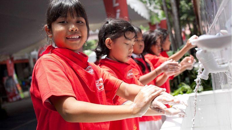 Schoolchildren washing their hands